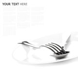 Close up of a silver spoon and fork on a white background. (with sample text Stock Images