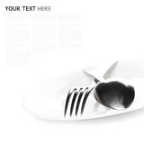 Close up of a silver spoon and fork on a white background. (with sample text Royalty Free Stock Photo