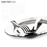 Close up of a silver spoon and fork on a white background. (with sample text Royalty Free Stock Images