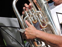 Close up of a silver tuba being played. Man playing a silver tuba horn as part of a small brass band at Woolaton Park, Nottingham , England in support of the Stock Image