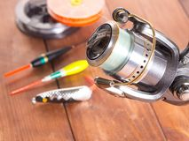 Spinning reel on the background of fishing gear. Close-up Stock Photography