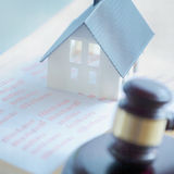 Close up Simple Miniature House on Top of Reports Stock Photos