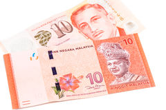 Close up of Singapore Dollar currency note against Malaysia Ring Stock Photo