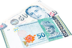 Close up of Singapore Dollar currency note against Malaysia Ring Stock Image
