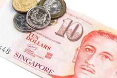 Close up on Singapore dollar currency notes and coins Stock Photos