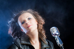 Close-up on the singer with microphone. On black background Stock Photography