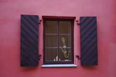 Close-up singl wood old window. (window frame in a pink house Royalty Free Stock Images