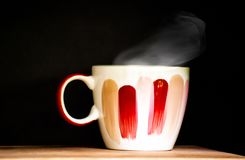 Close up Single cup of coffee on wooden table with beautiful smokey and black background.Wake up drink in the morning or coffee t. Ime in the afternoon stock photos