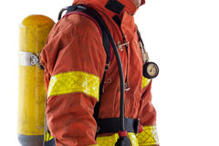 Close up single fireman in fire fighting protection suit and equ Stock Photos