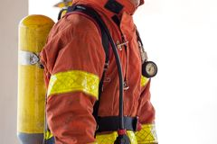 Close up single fireman in fire fighting protection suit and equ Stock Image