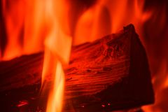 Close-up of single log in red fire flames. In a stove royalty free stock images