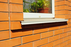 Close-up on single plastic window and metal sill detail. Install royalty free stock photography