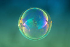 Close up of single soap bubble. Over blurred background Royalty Free Stock Photos