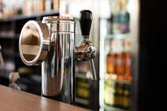 Close up of single tap chrome draft beer tower royalty free stock images