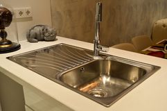Stainless steel sink and tap Royalty Free Stock Images