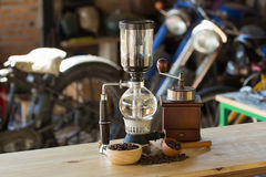 Close up of siphon vacuum coffee maker at shop. Royalty Free Stock Photography