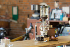 Close up of siphon vacuum coffee maker at shop. Stock Image