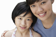 Close-up of sisters smiling over white background Royalty Free Stock Photos