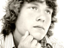 Close Up of Sixteen Year Old Teen Boy in Sepia Royalty Free Stock Photos