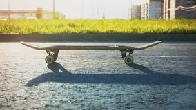 Close-up of skateboard on the background of road. In sunlight in summer season stock video