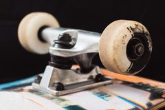 Close up skateboard truck and wheels. On black background. Professional extreme sport and skateboarding elements, axle, kingpin, bushing, hanger royalty free stock image
