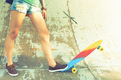 Close-up skateboarder girl with skateboard outdoor at skatepark Royalty Free Stock Photography