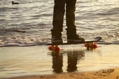 Close-up of the skateboarders feet royalty free stock images