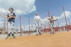 Close up of skateboarding family at playground. Happy family concept. stock photo