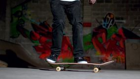 Close up of skater doing double flip trick Royalty Free Stock Image