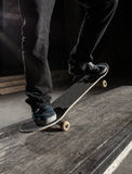 Close up of skater doing manual trick Stock Photography