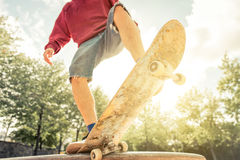 Close up on a skater and his skateboard Royalty Free Stock Image