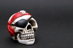 Close up of Skeleton pirate. On dark background stock photography