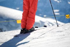 Close up of ski and trousers and ski pole Stock Photo