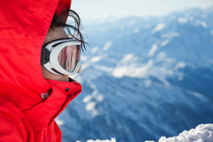 Close-up of skiing girl with goggles on slope Stock Photo