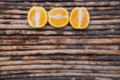 Close up skin and cross section orange on wood background Royalty Free Stock Photos