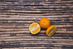 Close up skin and cross section orange on wood background Royalty Free Stock Photo