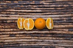 Close up skin and cross section orange on wood background Royalty Free Stock Photography