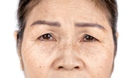 Close up skin wrinkle and freckles of old asian woman face. Wrinkle freckles and skin line on close up elderly asian woman face 60-70 years old, healthy skin stock photography