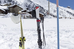 Close up of skis in the snow with background blue sky and the ski slope Royalty Free Stock Images