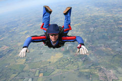 Close-up of skydiver in freefall. On a sunny day Stock Images