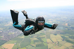 Close-up of skydiver in freefall. On a sunny day Royalty Free Stock Image