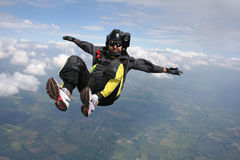 Close-up of Skydiver in freefall. Skydiver in a sit position while in freefall Royalty Free Stock Image