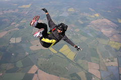Close-up of Skydiver in freefall. Skydiver in a sit position while in freefall Royalty Free Stock Photos