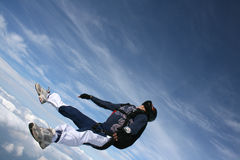 Close-up of Skydiver on his back in freefall. With some clouds in the background royalty free stock image