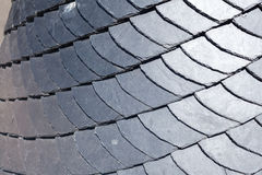 Close up of slate roof tiles background. Stock Photo
