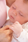 Close Up Of Sleeping Baby Boy Holding Mothers Hand Stock Images