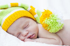 Close-up of sleeping newborn. Close-up sleeping newbornon a white background with bright hat stock photo