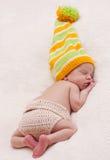 Close-up of sleeping newborn. Close-up sleeping newbornon a white background with bright hat royalty free stock image