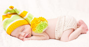 Close-up of sleeping newborn. Close-up sleeping newbornon a white background with bright hat stock images