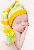 Close-up of sleeping newborn. Close-up sleeping newbornon a white background with bright hat royalty free stock photo